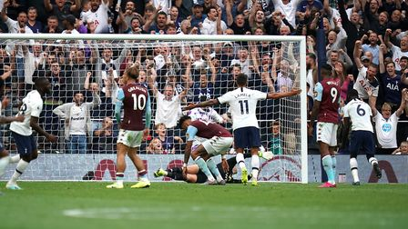 Tottenham Hotspur's Tanguy Ndombele (left) scores his side's first goal of the game against Aston Vi