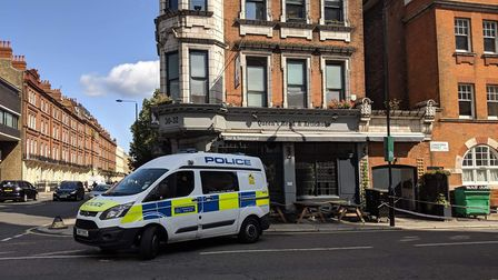 A police van outside the Queens Head and Artichoke pub. Picture: Sam Volpe