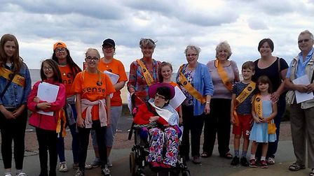 Staff and volunteers from the Sense charity shop at Lowestoft with members of the community at the w