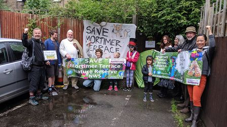 Campaigners outside of the locked gate to the Mortimer Terrace Nature Reserve. Picture: Sam Volpe