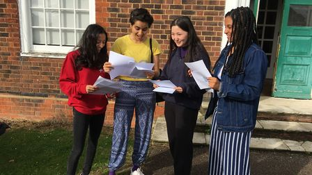 Henrietta Barnett pupils check their results outside the school in Central Square, Hampstead Garden