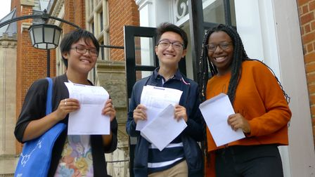 Highgate School pupils celebrate A-level results. Left to right. Aiden Tsen, Hongi Han and Ase Anifo