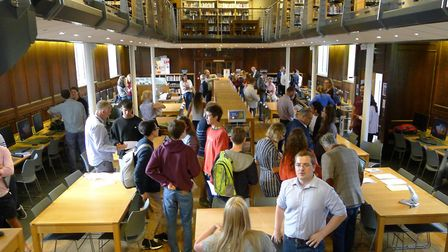 Students react to getting their A-level results in Highgate School's library on results day. Picture