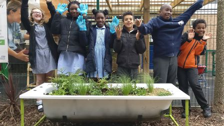 Year 6 pupils from St Monica's with their bath.