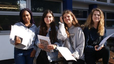Girls at Tetherdown hold their results papers in the August sunshine. (from L to R) Natalie, who wil
