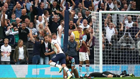 Tottenham Hotspur's Harry Kane (centre) celebrates scoring his side's second goal during the Premier