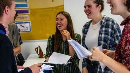 Students celebrate their results.