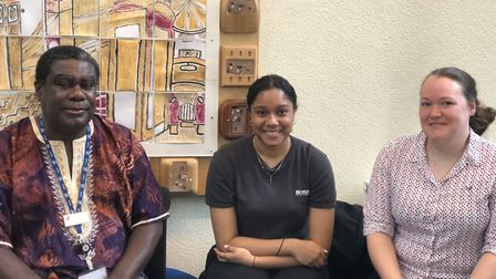 Biology teachers Ernest Asante (left) and Sarah March (right) with grade A student Chantel Singh, wh