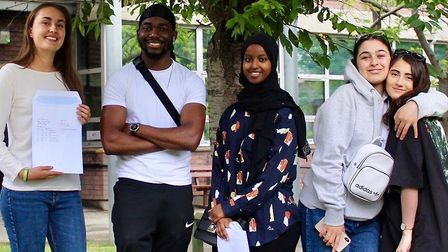 A band of celebrating A-level students at Hornsey Sixth Form College. Picture: HSFG