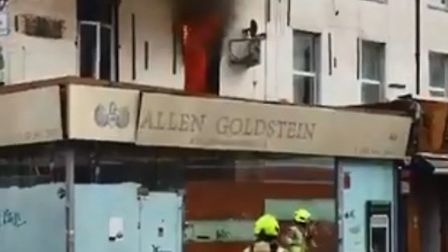 A flat above a shop in Camden Town is on fire. Picture: Max (@hot4scott)