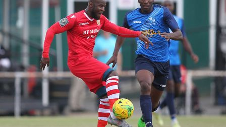 Daniel Uchechi of Hornchurch and Olu Oluwatimilehin of Wingate and Finchley during Hornchurch vs Win