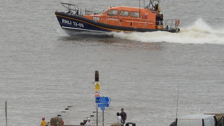 Lowestoft lifeboat speeding past Links Road and heading for the North Beach at LowestoftPicture: Mic