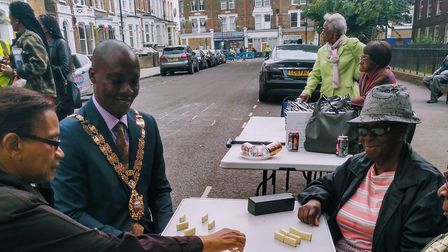 Speaker of Hackney, Cllr Kam Adams, playing dominoes with Windrushers at the Windrush Generation Str