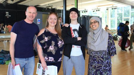An Acland Burgley pupil celebrates with his mum and teachers after getting his GCSE results. L to R.