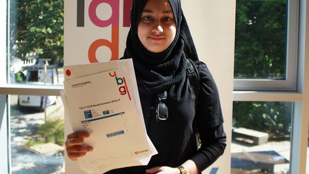 Tania Sultana with her GCSE results. Picture: Acland Burghley School