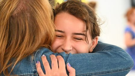Sasha Lewis hugs a friend as she gets her GCSE results at Parliament Hill School yesterday. She got