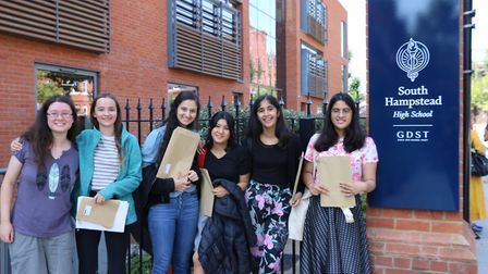 South Hampstead High School pupils celebrate their grades on GCSE results day outside the school in