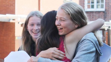 Students from Clapton Girls' Academy celebrate their GCSE results.