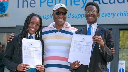 Twins Deborah and Samuel Shonibare with dad Henry. Picture: Gary Manhine
