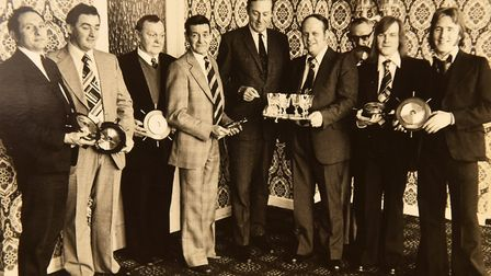 Alfred Draper (fourth from left) pictured receiving a commerative barometer as part of the crew of t