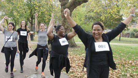 Fun runners and walkers celebrate completing the 5 kilometer course. Picture: Rudy Atwell