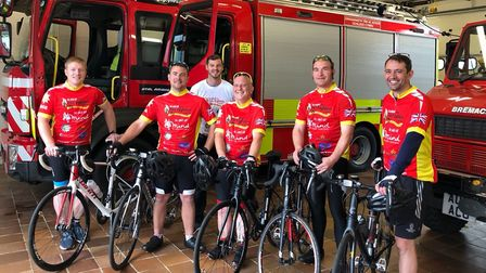 The Wrentham crew at Llangefni Fire Station in Wales, about to begin their 381 mile cycle ride. Pict