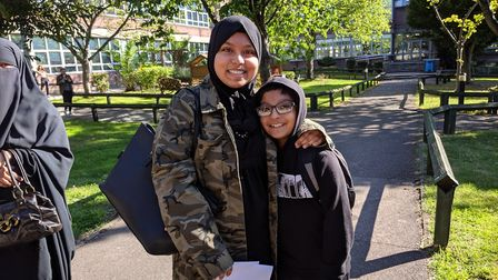 Fatema Sikdar, 16, with her little brother who wants to beat her stunning six grade 9s at GCSE some