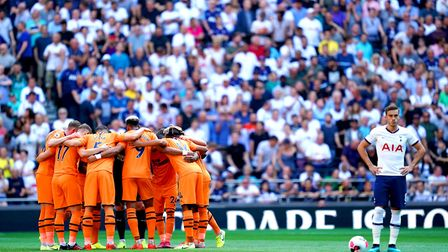 Newcastle United players huddle together prior to the beginning of the Premier League match at Totte