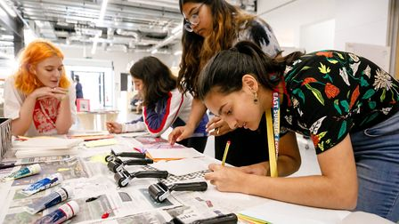Youngsters get stuck in with a magazine making course with UCL special collections. Picture: Rahil A
