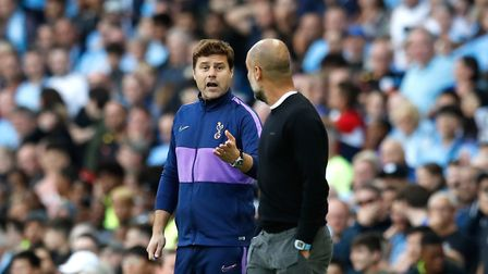 Tottenham Hotspur manager Mauricio Pochettino (left) and Manchester City manager Pep Guardiola speak