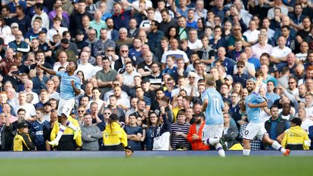 Manchester City's Raheem Sterling celebrates scoring his side's first goal of the game during the Pr