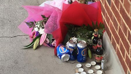 Tributes left outside Ms Samuels' flat on the Milton Gardens Estate. Picture: Lucas Cumiskey
