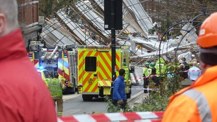 Emergency services deal with the aftermath of the scaffolding collapse in Pond Street. Picture: Ron