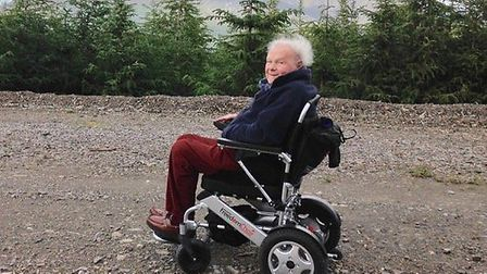 Robin Farlie in his motorised wheelchair, during a holiday to the Lake District earlier this year. P
