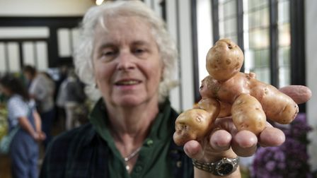 Yvonne Oliver with her Potato man at HGS Horticultural Soc Autumn show. Picture: Nigel Sutton