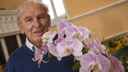 Alan Dallman with his prize winning Orchid Highgate Horticultural Soc Autumn show. Picture: Nigel Su