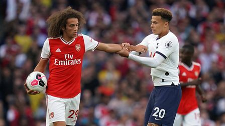 Arsenal's Matteo Guendouzi (left) and Tottenham Hotspur's Dele Alli argue over the ball during the P