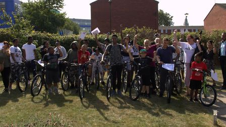 Children from the CAMHS bike project celebrate finishing the course with their families and CAMHS st