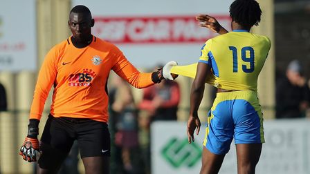 George Kamurasi of Herne Bay and Chid Onokwai of Haringey square up during Haringey Borough vs Herne