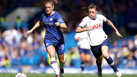 Chelsea's Maren Mjelde (left) and Tottenham Hotspur's Lucy Quinn battle for the ball during the FA W