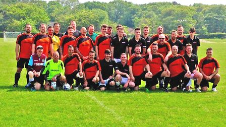The teams line up for the charty football match. Picture: Mick Howes
