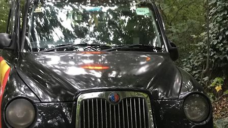 The black cab that has been left in woods near Highgate Woods school. Picture: Gemma Blencowe