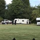 Police with the Travellers on Thursday. Picture: Adrian Zorzut