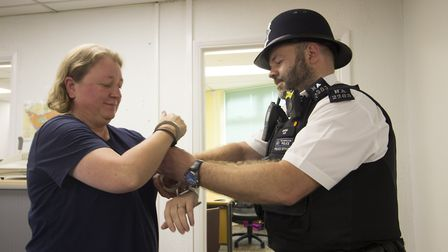 Tracey Gilbert-Falconer from my AFK is arrested by Crouch End's PC Chris Allen. Picture: my AFK