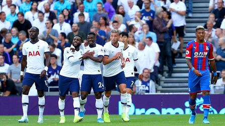 Tottenham Hotspur players celebrate as Crystal Palace's Patrick van Aanholt (right) scores an own go