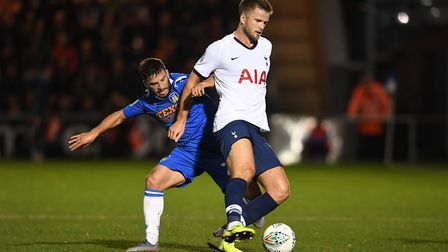 Colchester United's Luke Gambin and Tottenham Hotspur's Eric Dier (right) battle for the ball during