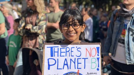 Youngsters make their own placards for the climate emergency rally outside Hackney Town Hall. Pictur