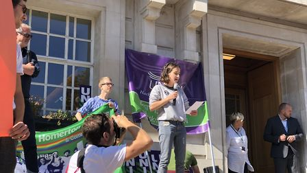 An extinction rebellion campaigner urges the government to take action at the climate emergency rall