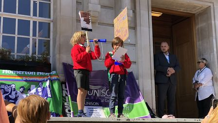 """Two young boys warn: """"We have to be careful"""" at the climate emergency rally outside Hackney Town Hal"""