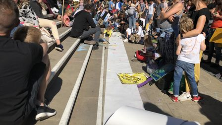 Youngsters drew on a long strip of paper at the foot of the town hall steps as the climate emergency